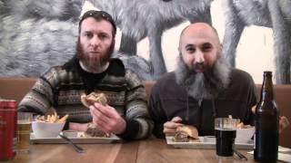 Two Bearded Men Eating Hamburgers