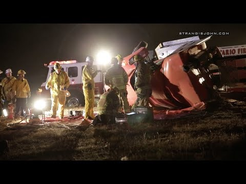 Ontario: Semi Truck Crashes and Overturns, Driver Trapped