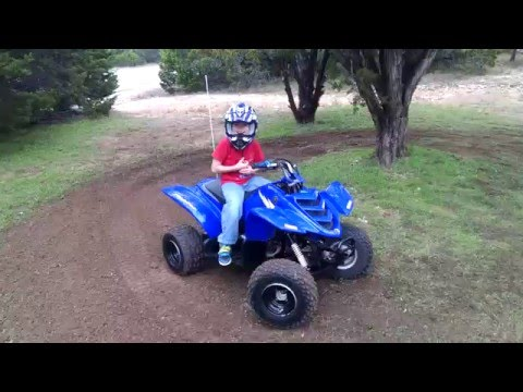 Six year old ripping it up on a Yamaha Raptor 50