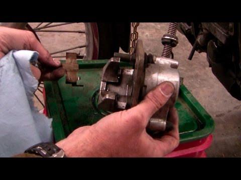 Replace front motorcycle brake pads, 1995 Kawasaki Vulcan