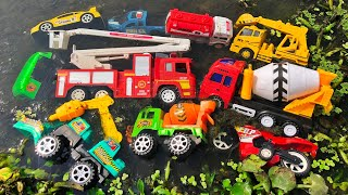 Looking for toy vehicles in the small water canal | Fire engine, Police Car, Construction Trucks