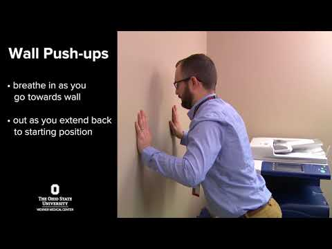 Exercises to prevent back pain: wall push-ups