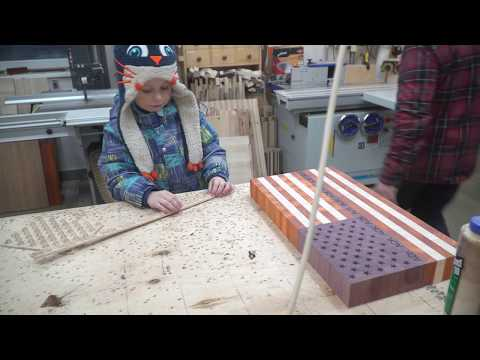 Matvei is helping to make US flag end grain cutting board