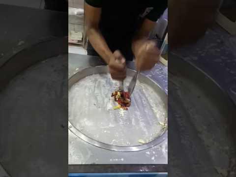 Amazing ice-cream maker making live ice-cream