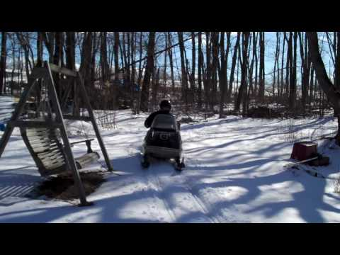 Two kids in a snowmobile caboose skiboose #1