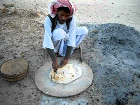 Bedouin making us bread. Eastern desert, Egypt March 2011.