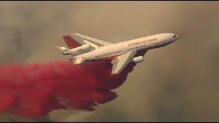 RAW: CalFire Tanker Drops Fire Retardant On Canyon Fire In Southern California