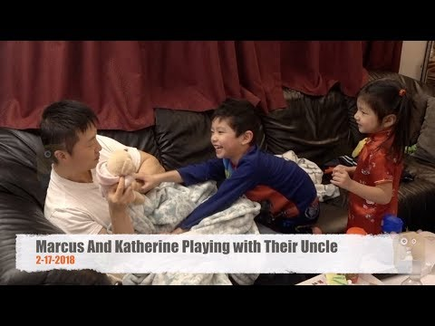 Marcus And Katherine Playing with Their Uncle