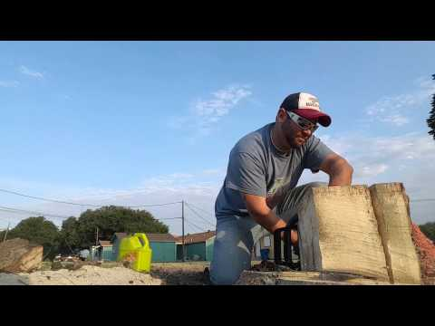 Cutting a tree stump level with the ground.