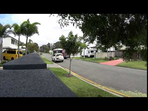 Queensland bus traveling dangerously on small road in Noosaville