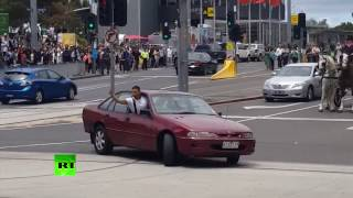 Rogue red car 'driving erratically' caught on cam before ramming into crowd in Australia