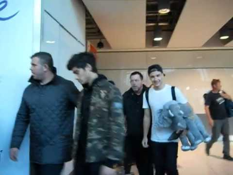 One Direction, minus Harry, arriving at Heathrow Airport Terminal 5 - 8/12/12