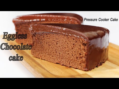 How to make Eggless Chocolate Cake in Pressure Cooker | Pressure cooker cake Recipe | MadhurasRecipe