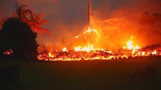 Hawaii volcano spews lava and toxic gas through new cracks