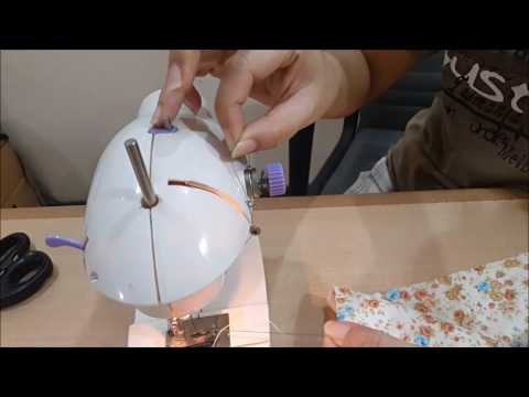 How to use a portable mini sewing machine with pedal video on how to finish the seam