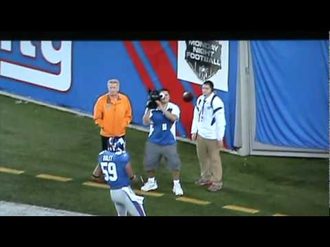 Giants player throws football at some guys face