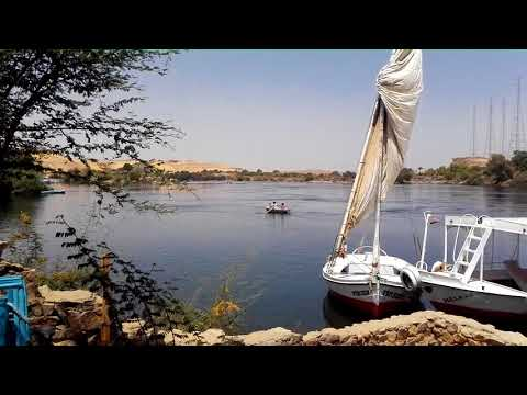 A Nubian dad rows a boat on the Nile with his two kids