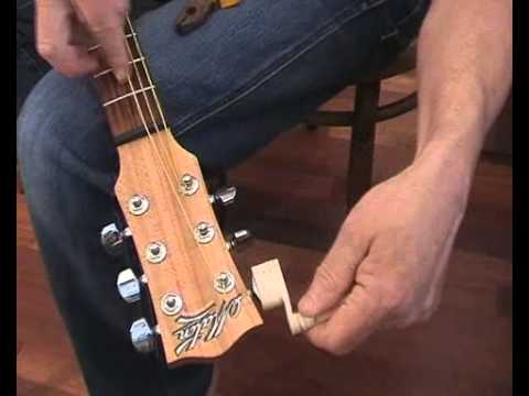 Changing strings on a steel string guitar - the headstock view - from gutarforbeginners.com