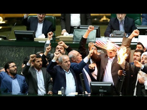 Iranian lawmakers set paper US flag on fire