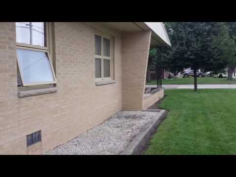 Painting a brick ranch by Custom Coatings Part 1