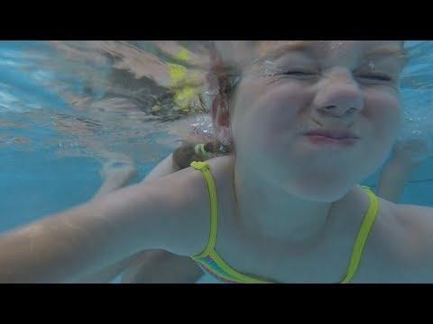Water Fun In Pool Kids Swim underwater Jumping and Slide in Pool