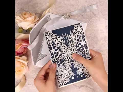 Perfect snow flake design, glitter silver laser cut invitations for the winter wedding.