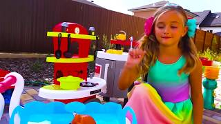Sasha Playing with cute kitchen and kids cooking playset