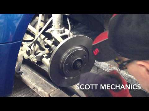 How to replace Front bakes disc and pads on a Citroen  c2 1.1 Scott mechanics