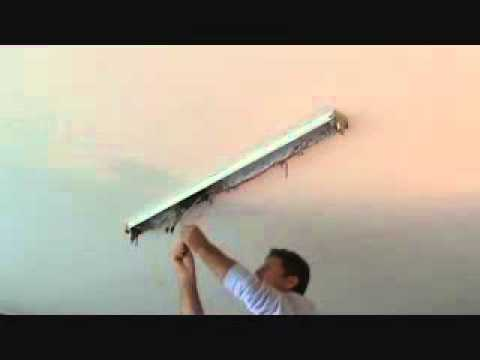 How to install a surface mounted fluorescent light fixture...Part 2