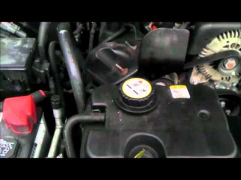 Coolant Flush and Thermostat Exchange on a Ford Panther Platform vehicle
