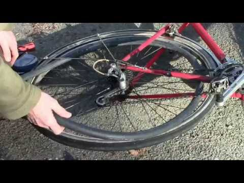 Exposing the inner tube without removing the wheel