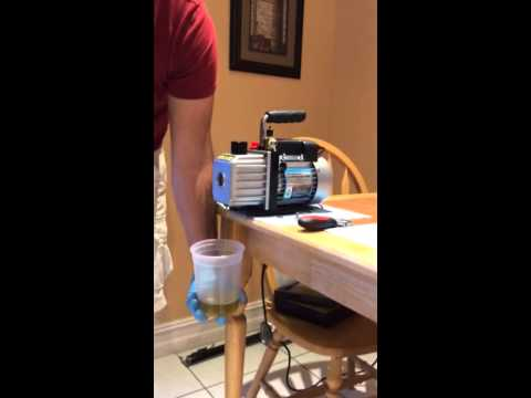 How to change the oil on a vacuum pump