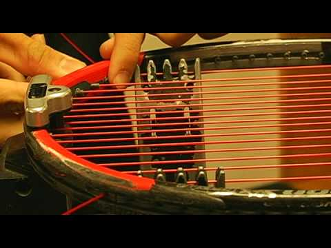 How to String a Tennis Racquet- Basic Weaving Demo ( Audio replaced with Music))