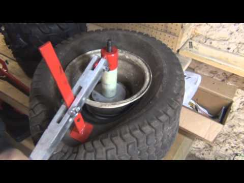How to change A Lawn Mower   ATV  4 Wheeler   Tire Using A Harborfreight Mini Tire Changer video