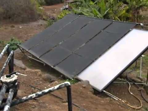 Swimming pond heated by solar panels