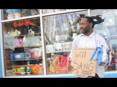 Homeless man sings John Legend's
