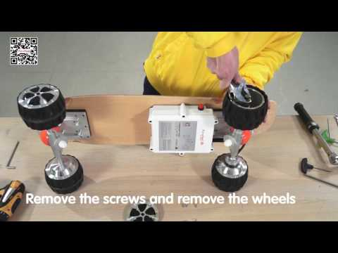 Airwheel M3 electric skateboard to tighten the motor wheel and replace the non drive wheels