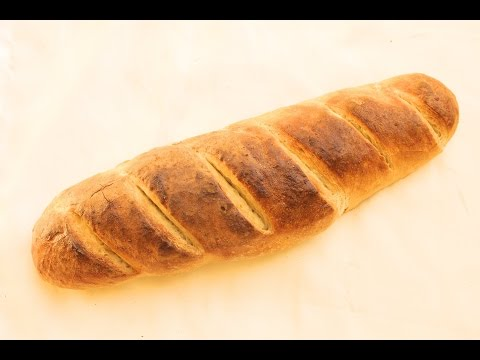 French bread, crusty on the outside, soft on the inside (French)