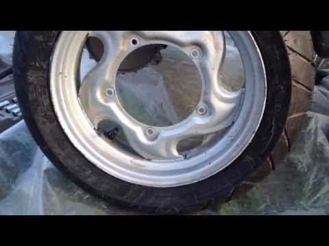 How to replace a scooter rear tyre inflate a tubeless and remove exhaust