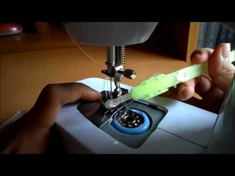 How to get the Thread from the Bobbin Case | Portable Sewing Machine