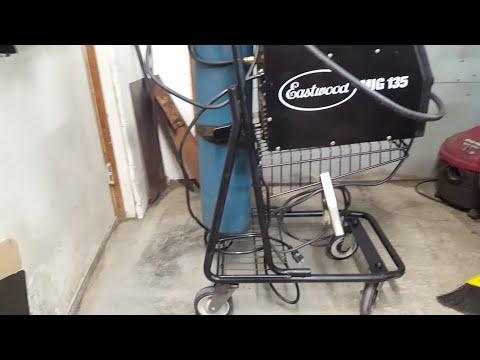 DIY welding cart made from an old shopping cart.