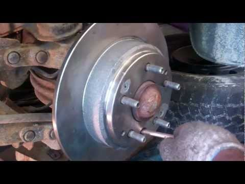 Releasing safety brake to change a rear rotor