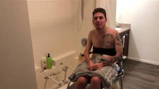 Paralyzed Quad Showers Over A Tub Using Special Chair