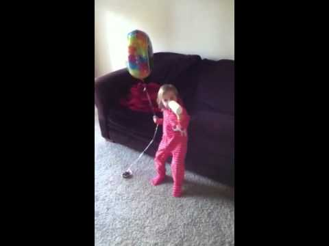 Olivia Largen with Bottle Balloon and Dora