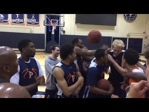 Watch a college hoops team go nuts when walk-on gets awarded scholarship