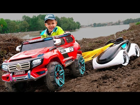 Power Wheel car Stuck in the mud Funny KID Ride on Power Wheels cars and Towing car Video for kids