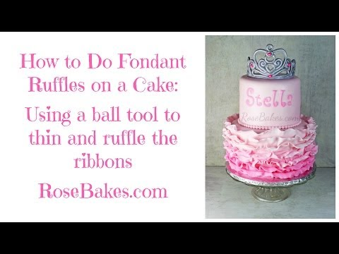 How to Do Fondant Ruffles on a Cake: Using a ball tool to thin and ruffle the ribbons.