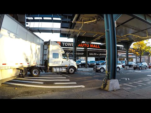 Truck making a tight turn from Queens Boulevard in Long Island City, Queens, NYC