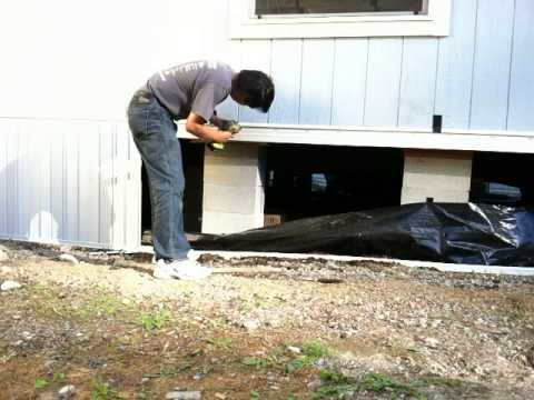 Time lapse of vinyl skirting manufactured home