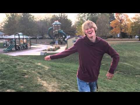 Blonde boy flips his hair